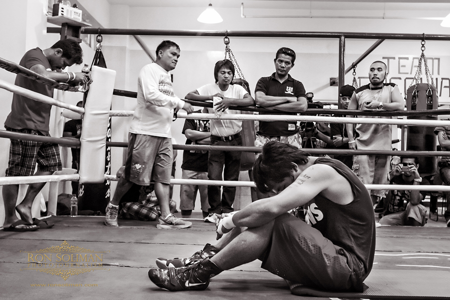 Manila, Philippines - World Boxing Champion and Congressman Manny 'Pacman' Pacquiao pauses in prayer at the conclusion work-out. Recently, Pacquiao became very religious and has changed his old ways. He is often seen preaching at Bible studies and quoting bible passages during media interviews. Pacquaio begins his training at MP Tower gym in Manila on April 17, 2012 in preparation for his fight against American boxing champion Timothy Bradley in Las Vegas on June 9, 2012. The MP Tower gym, a six-level building located in the outskirts of Manila is used to be the old L&M Gym, where Pacquaio first trained as a boxer when he was 17 years-old.  Photo by Ron Soliman
