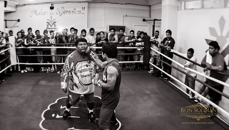 Manila, Philippines Childhood friend and assistant trainer Buboy Fernandez (left) receives a punch from World Boxing Champion and Congressman Manny 'Pacman' Pacquiao as he trains at the MP Tower gym in Manila on April 17, 2012 in preparation for his fight against American boxing champion Timothy Bradley in Las Vegas on June 9, 2012. The MP Tower gym, a six-level building located in the outskirts of Manila is used to be the old L&M Gym, where Pacquaio first trained as a boxer when he was 17 years-old.  Photo by Ron Soliman