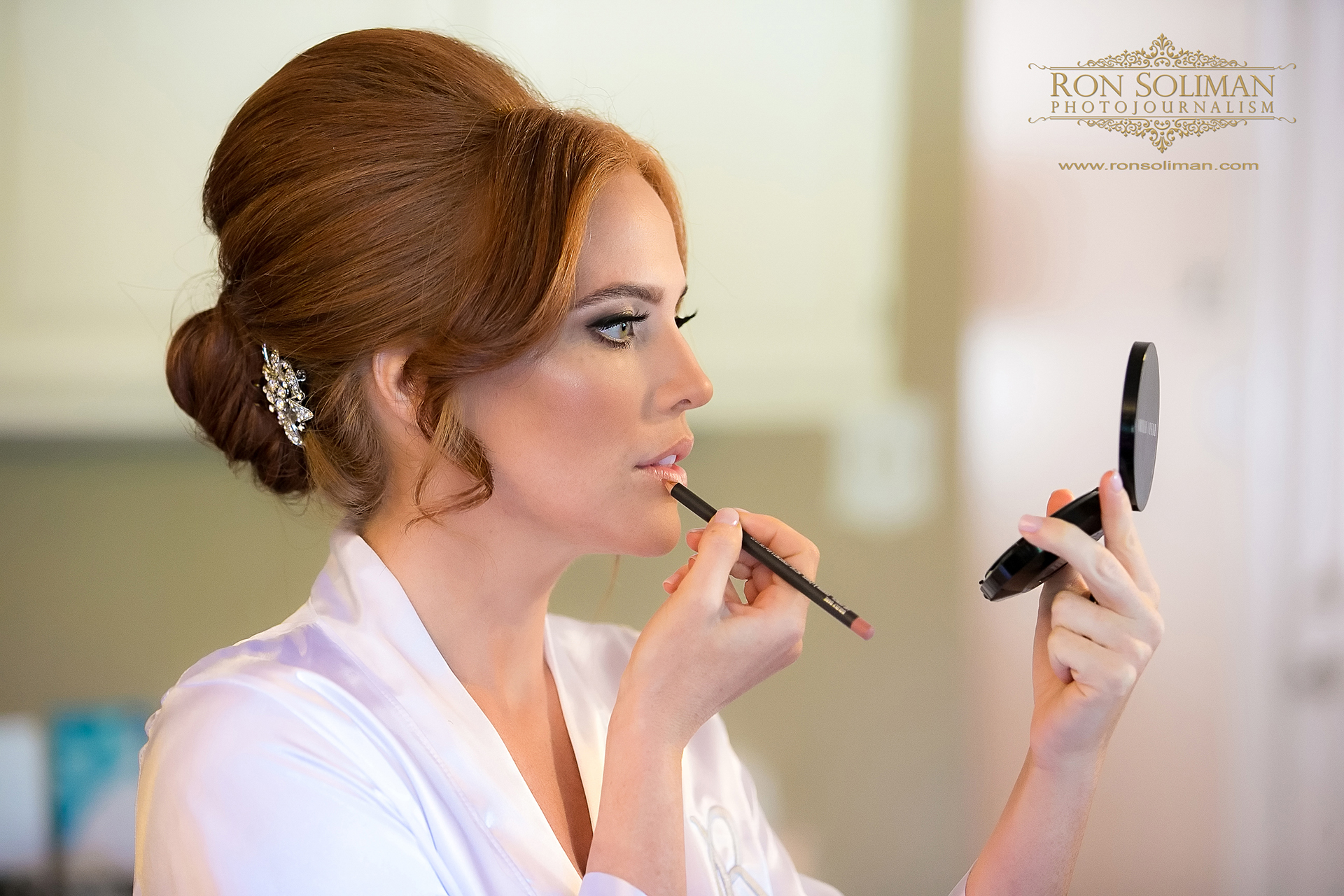 bride putting on make-up