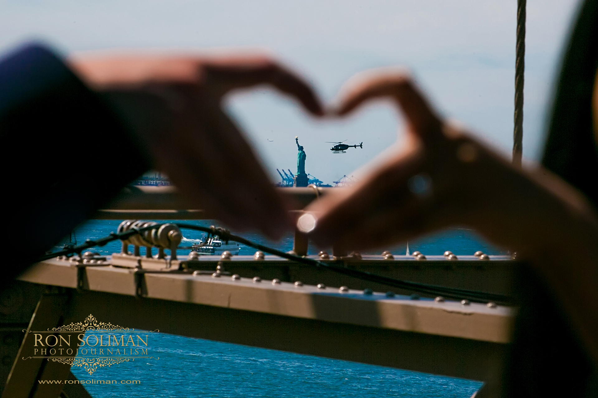 statue of liberty engagement photo
