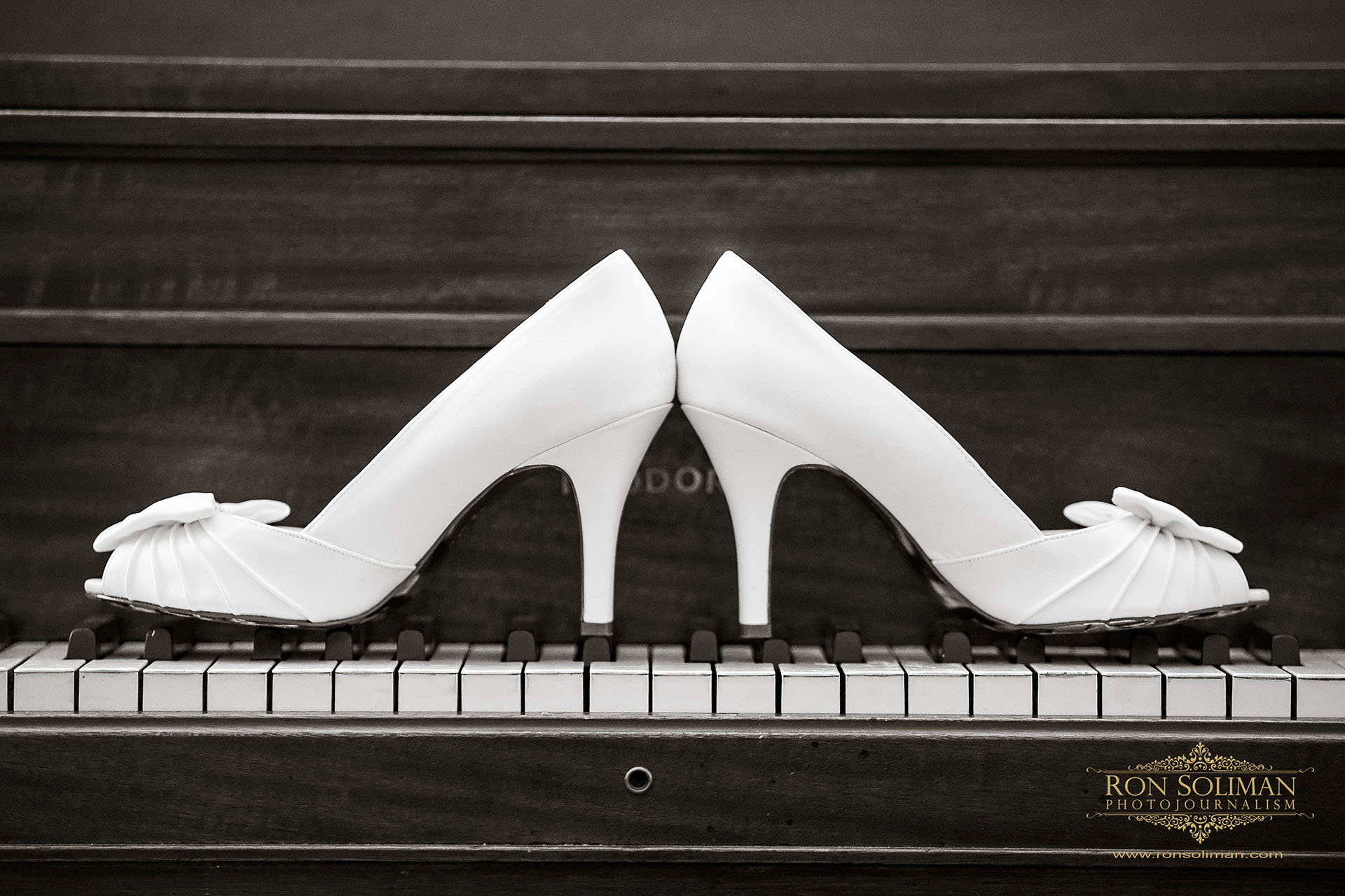 wedding shoes on a piano